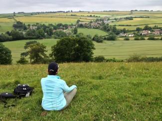 Lady sitting on hillside